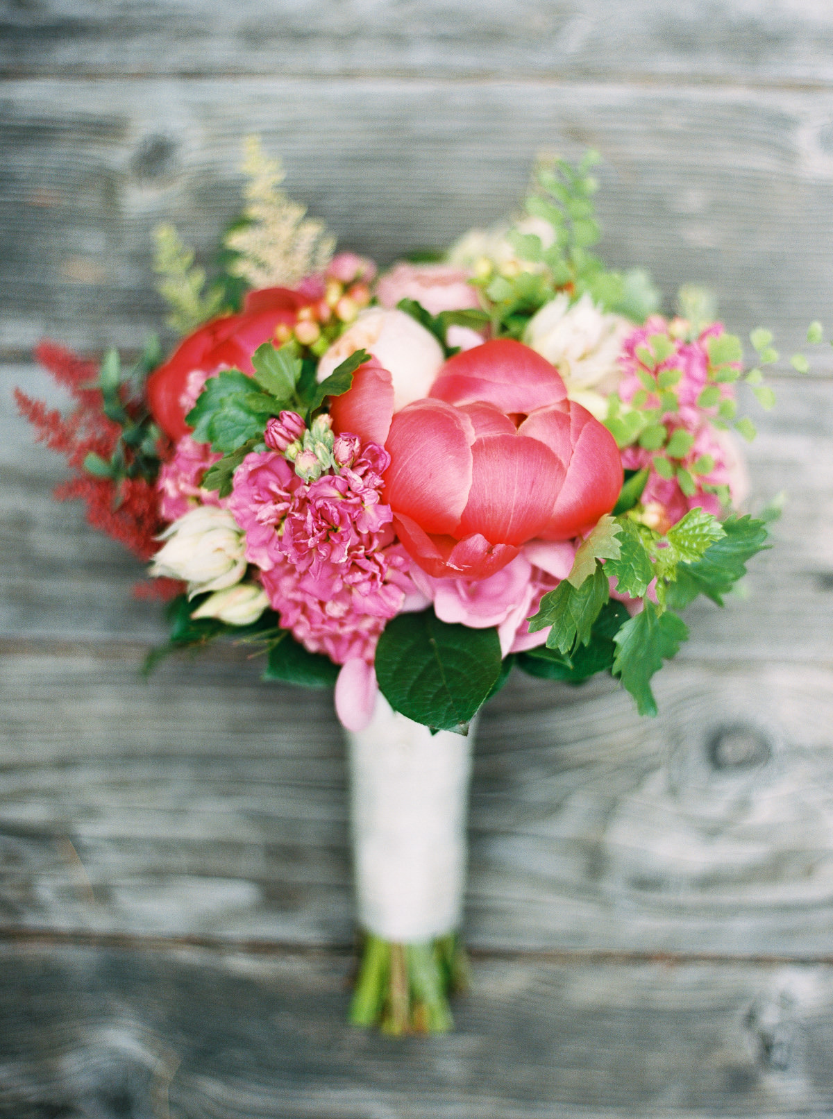 Vibrant bridal bouquet captured by top Seattle Wedding Photographer Anna Peters at Kiana Lodge