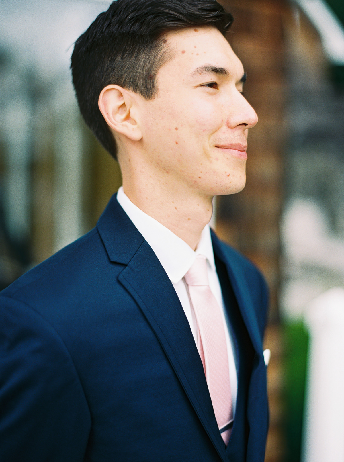 Groom in navy and blush at a Kiana Lodge wedding by Anna Peters