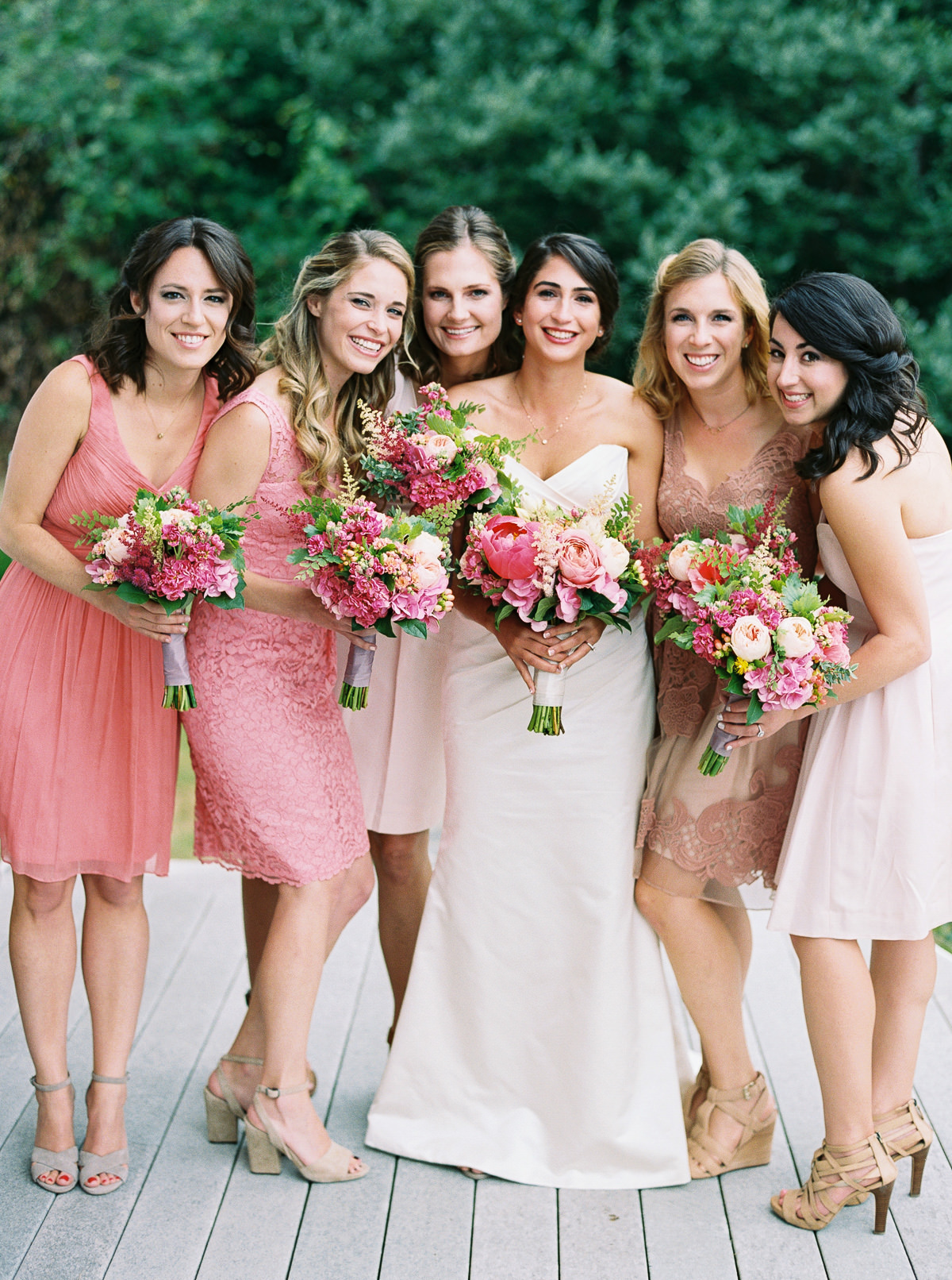 Bridesmaids in pink at an elegant Kiana Lodge wedding photographed by Anna Peters