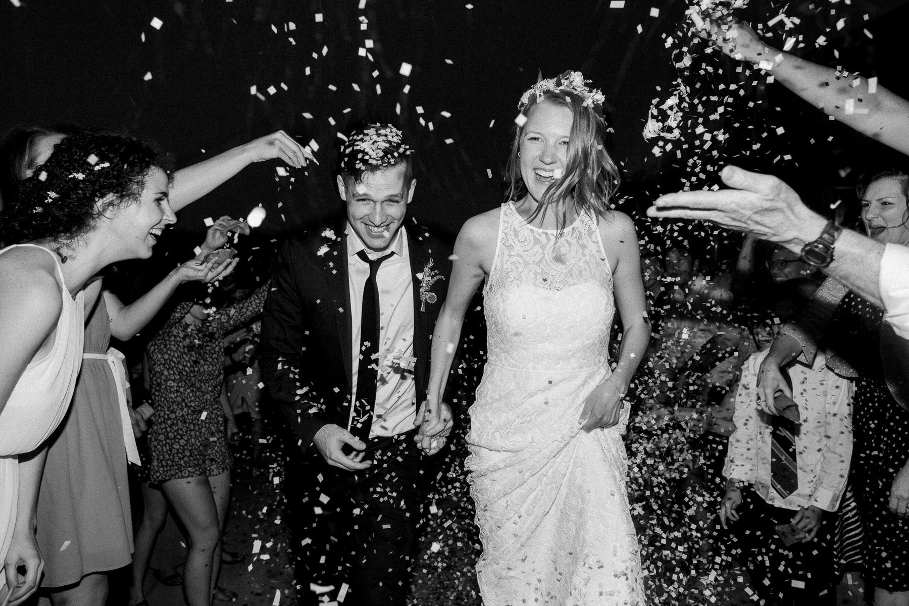 Confetti Wedding Exit at Spokane Wedding Venue Trezzi Farms Winery by Anna Peters
