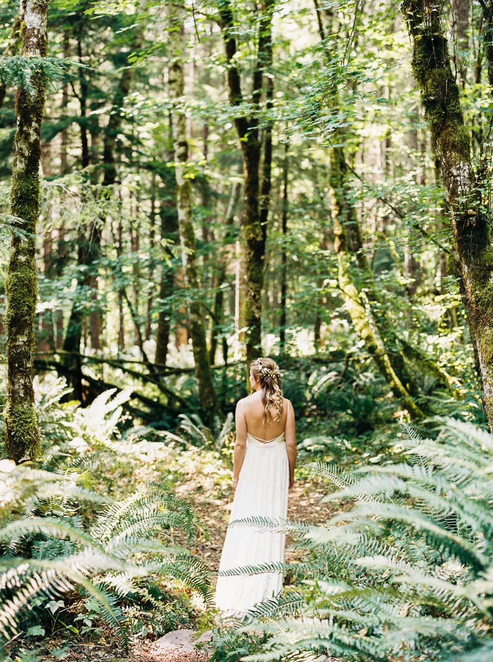 Bride wanders through forest at Wellspring Spa Wedding at Mt. Rainier