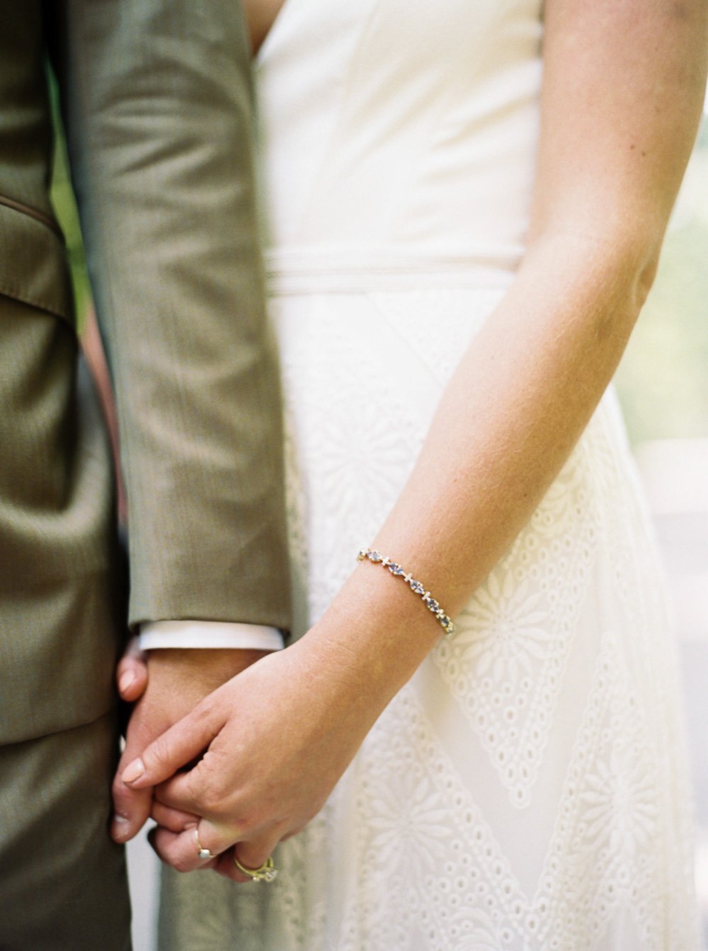Bride and Groom hold hands at Wellspring Spa Wedding at Mt. Rainier