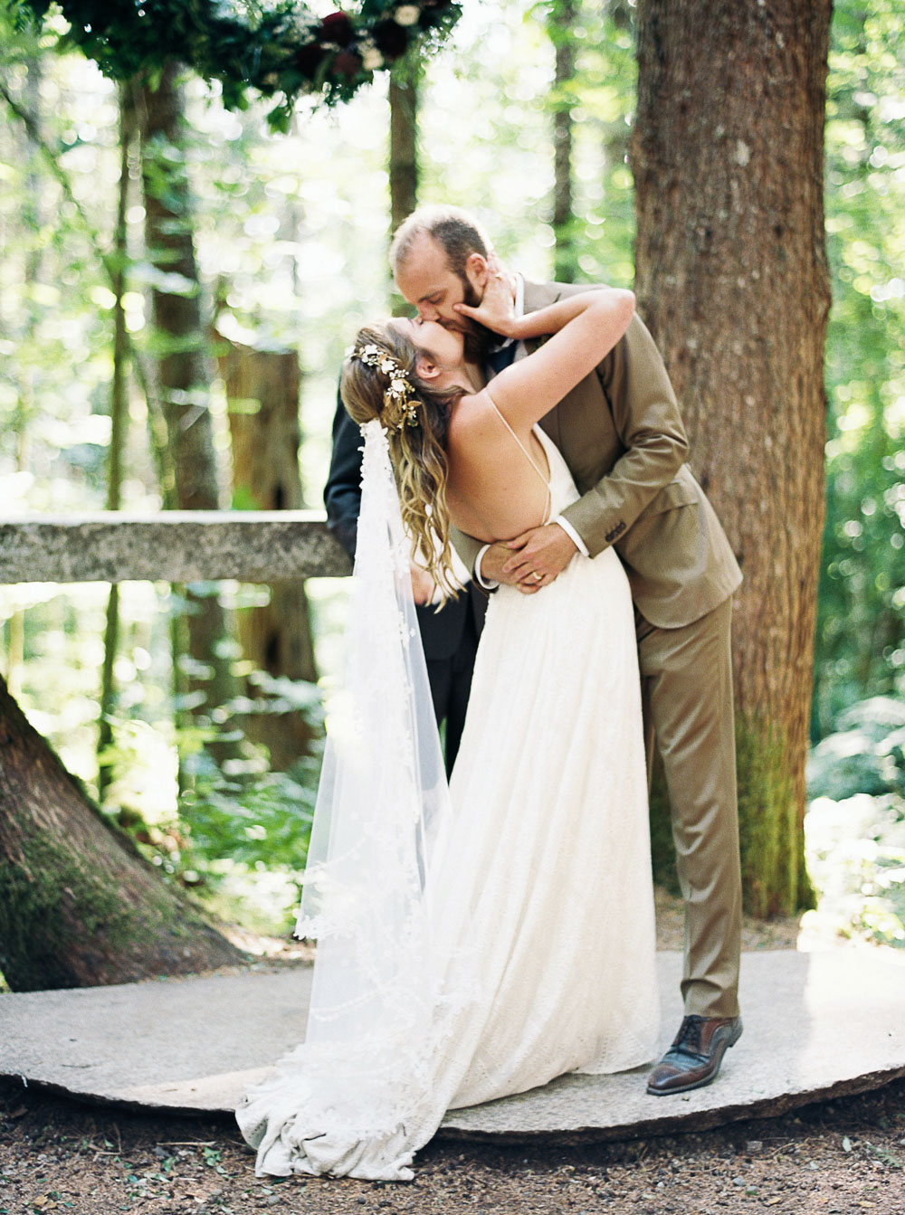 Bride and groom's first kiss at Wellspring Spa Wedding near Seattle