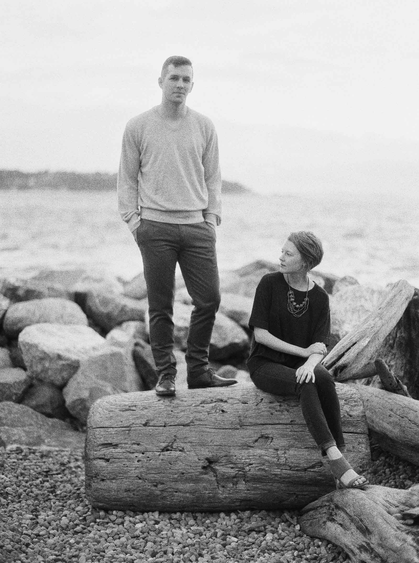 Classic black and white portrait of a couple on the water by Seattle Engagement photographer Anna Peters