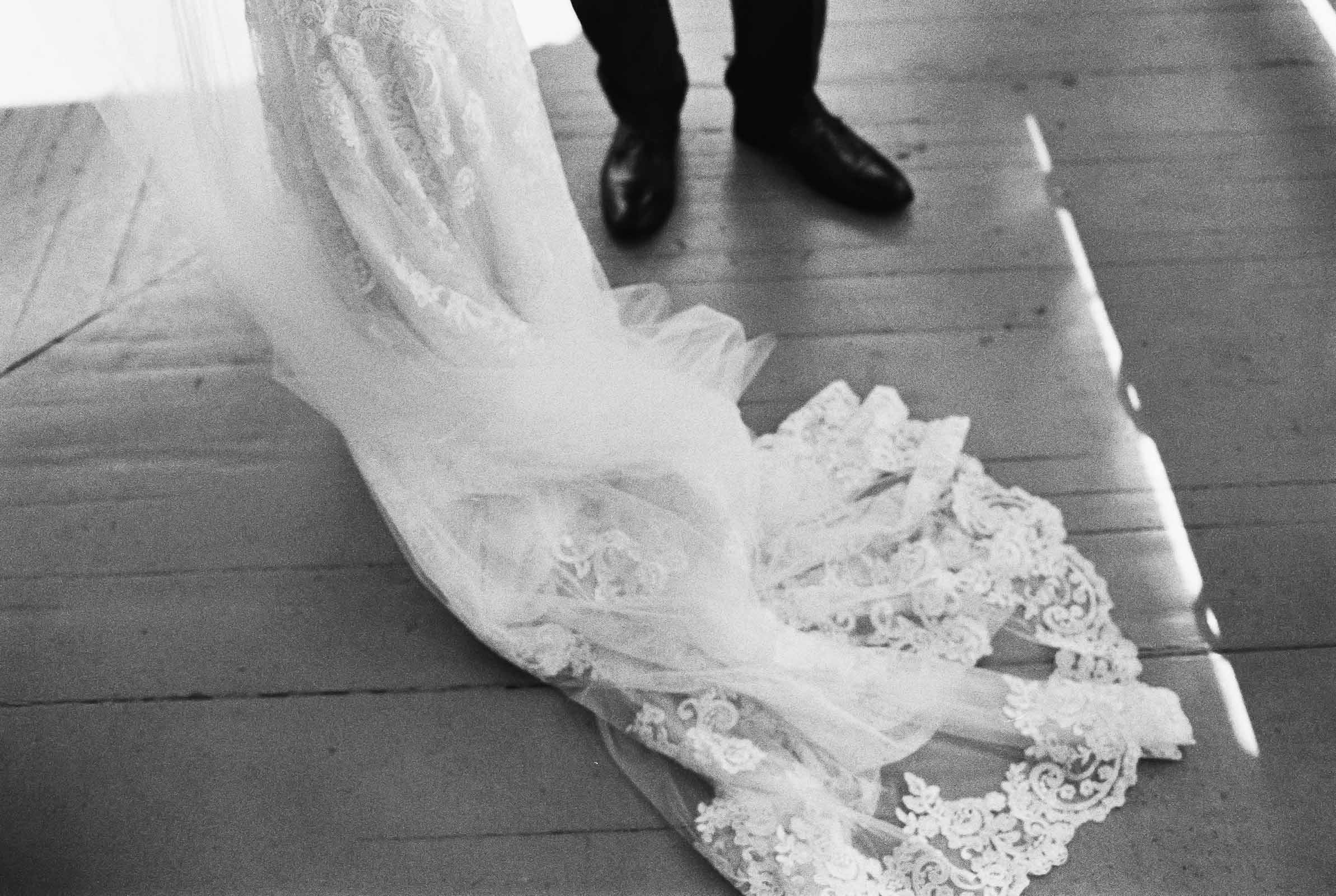 Lace wedding gown and veil captured in black and white at Seattle Wedding venue Lord Hill Farms
