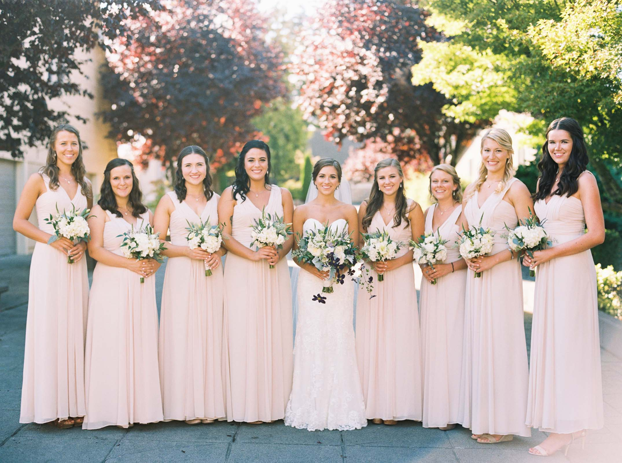 Bridesmaids in blush at a Lord Hill Farms wedding by Seattle wedding photographer Anna Peters