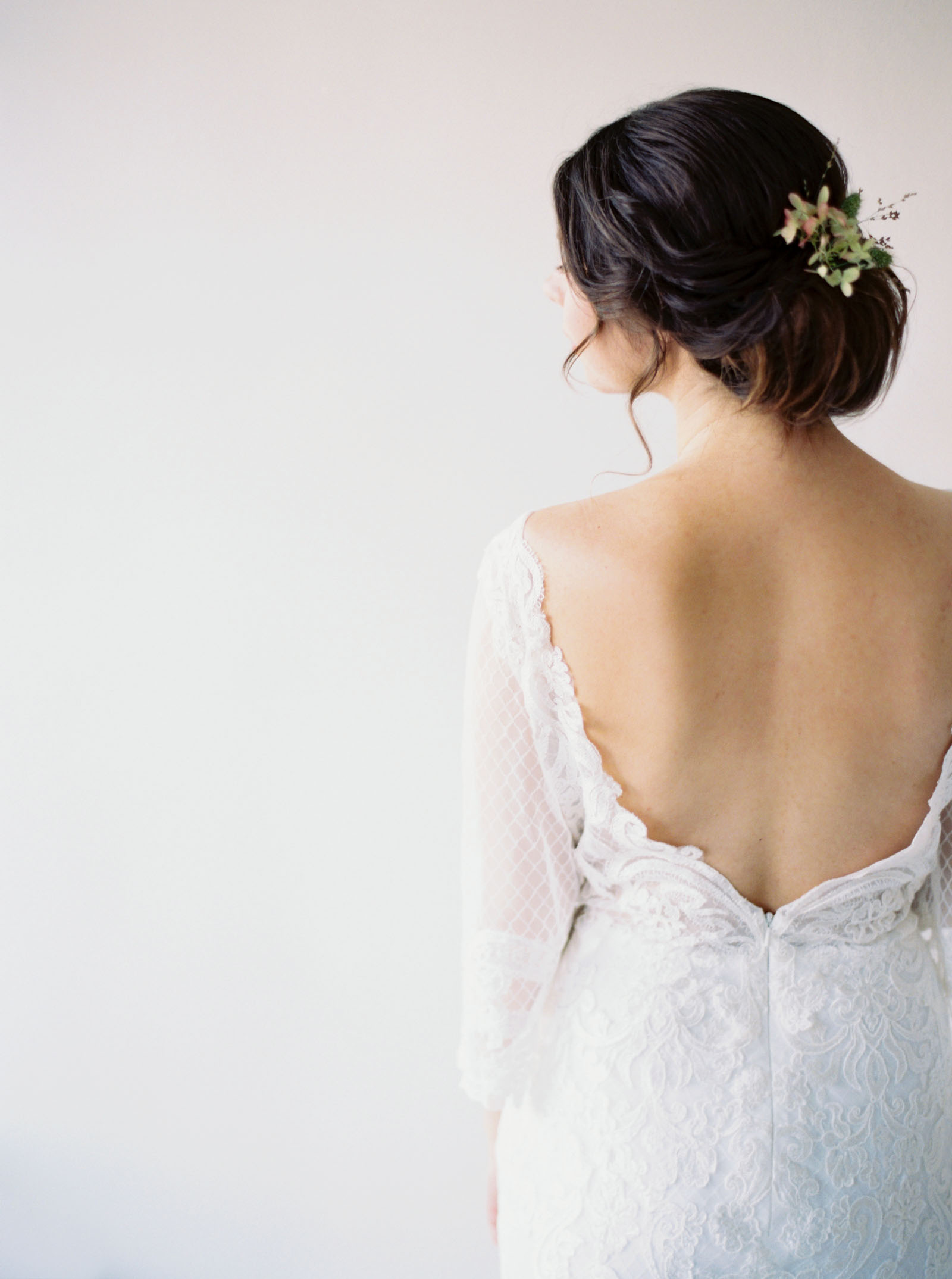 Low back wedding gown captured on film by Seattle Wedding Photographer Anna Peters