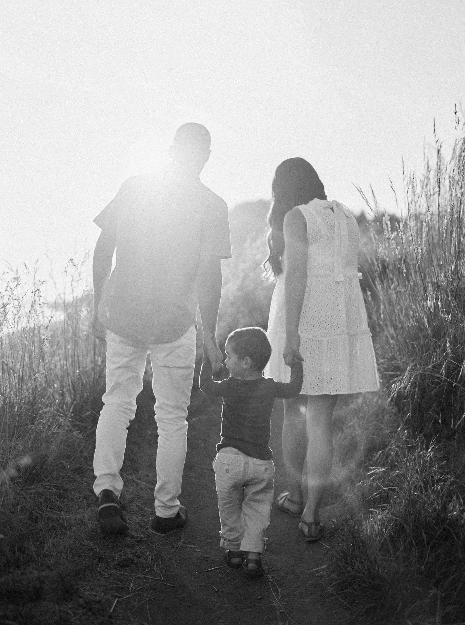 Walking up the cliff at sunset captured on film by Seattle Family photographer Anna Peters