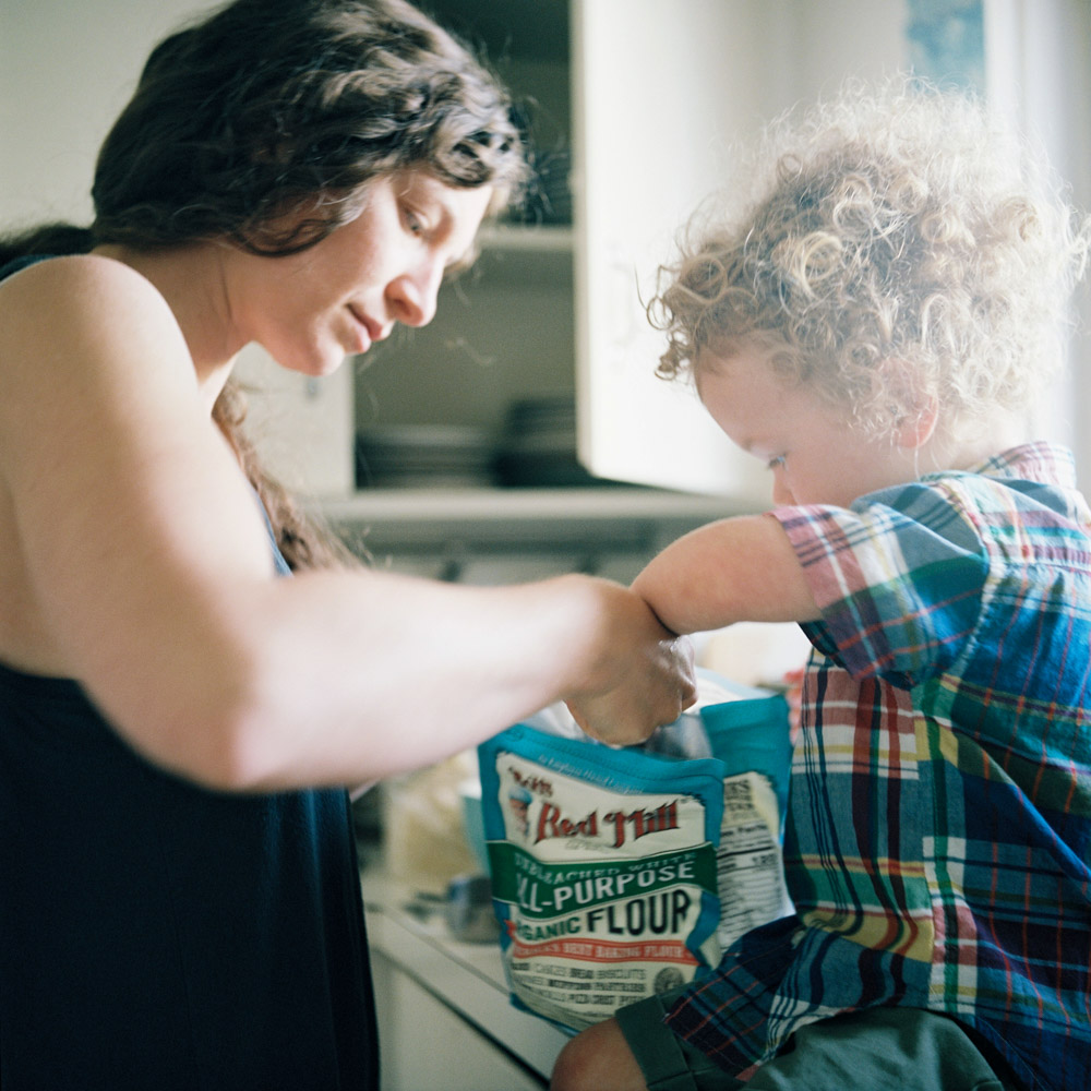 Making pancakes at a candid family lifestyle session captured on film by Anna Peters