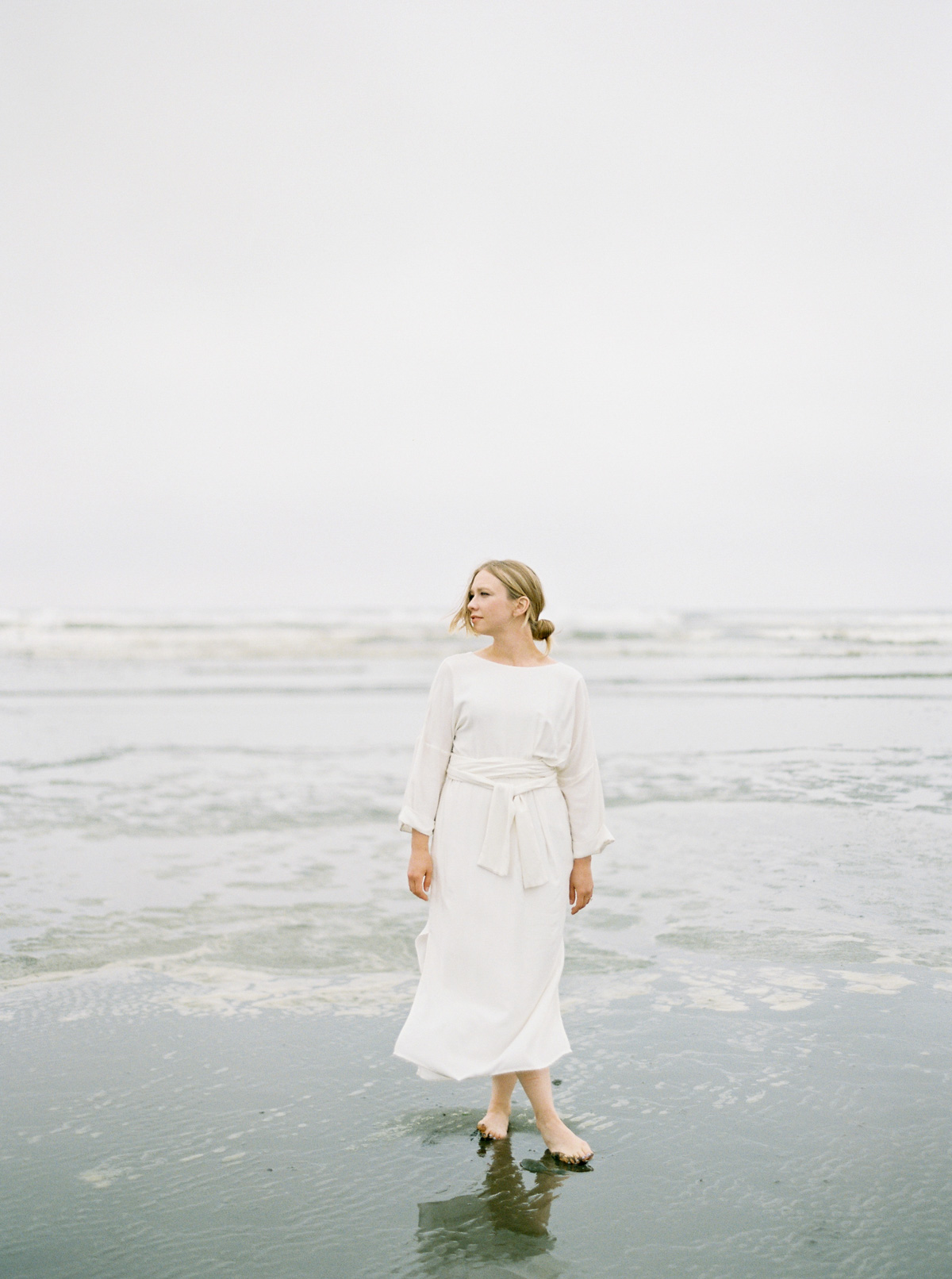 Photograph of a woman in a white dress near the ocean from Seattle Lifestyle photographer Anna Peters